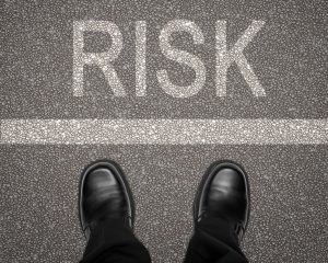 Man looking across the line at risk - Risk Management Principles
